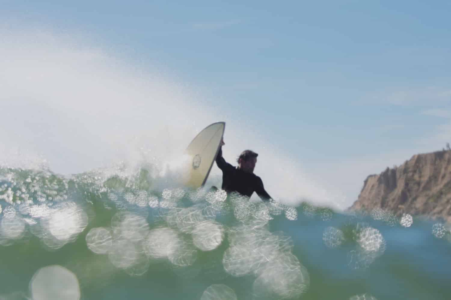 Surfer Hitting the Lip